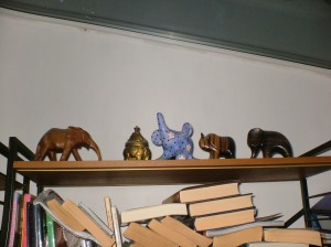 elephant shelf above bookshelf