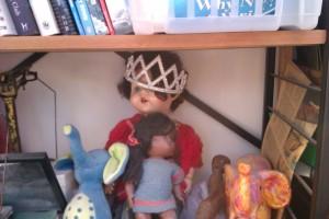 Dolls on a shelf